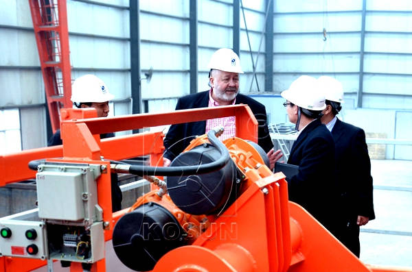 Clients Checking Equipment on Factory Worksite